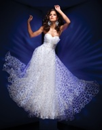 Fairy-tale style evening gown with figure-hugging bodice and flowing skirts by Tony Bowls Evening.